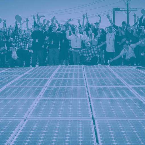 A community celebrating a solar array