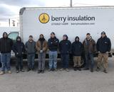 The workers of Berry Insulation pose in front of their company's truck